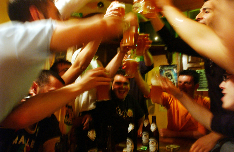 "STRASBOURG, FRANCE - MAY 18: Italian students from the Primo Levi Technical Institute of Vignola in the Modena Province, toast with glasses of beer in a pub during a school trip to Strasbourg, France to visit the European Parliament on May 18, 2004. School trips can be a sort of initiation trip for teenagers, where they are introduced for the first time to alcohol and drugs. Many times they don't sleep for the whole trip. The trips often allow the students to get to know each other better. If one is considered ""different"" than the group, it can be a nightmare experience for the teenager. Mainly the teenagers are only interested in clubs, shopping and having a pizza instead of the cultural aspects of the school trip. (Photo by Marco Di Lauro/Getty Images)"