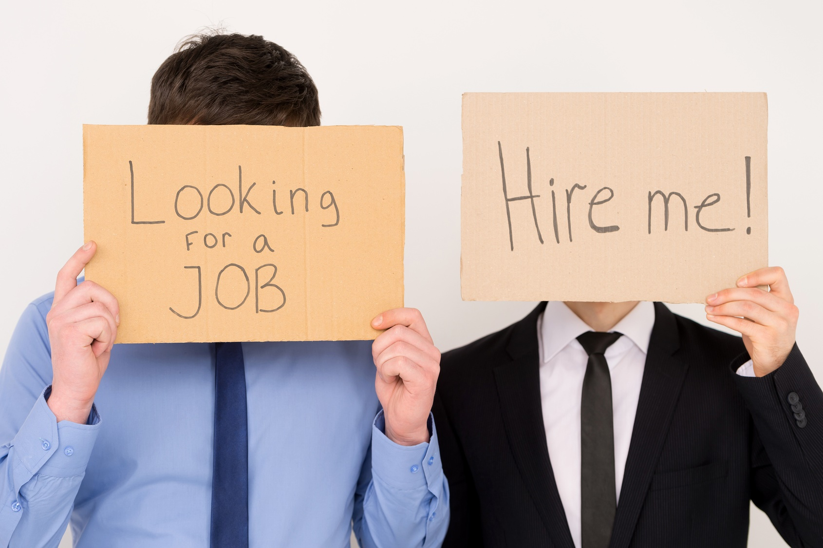 Unemployment Workers. Unemployed office workers holding cardboard signs job hunting