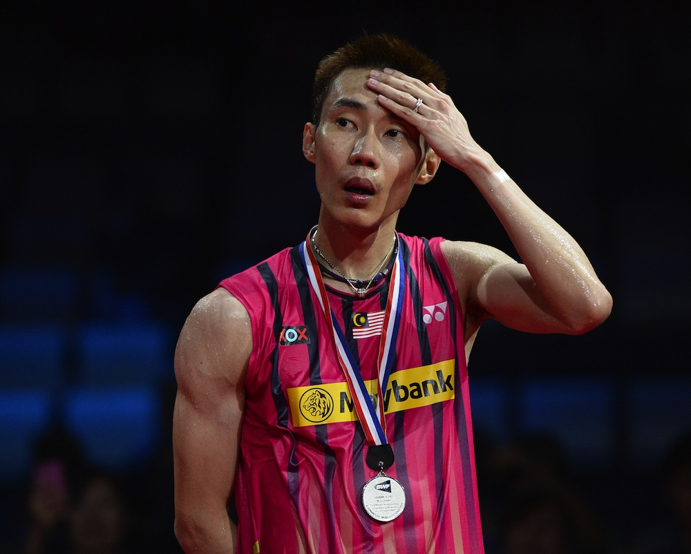 Silver medalist Malaysiaís Lee Chong Wei reacts during the awards ceremony after the men's single final match at the 2014 BWF Badminton World championships held at the Ballerup Super Arena in Copenhagen on August 31, 2014. AFP PHOTO / JONATHAN NACKSTRAND