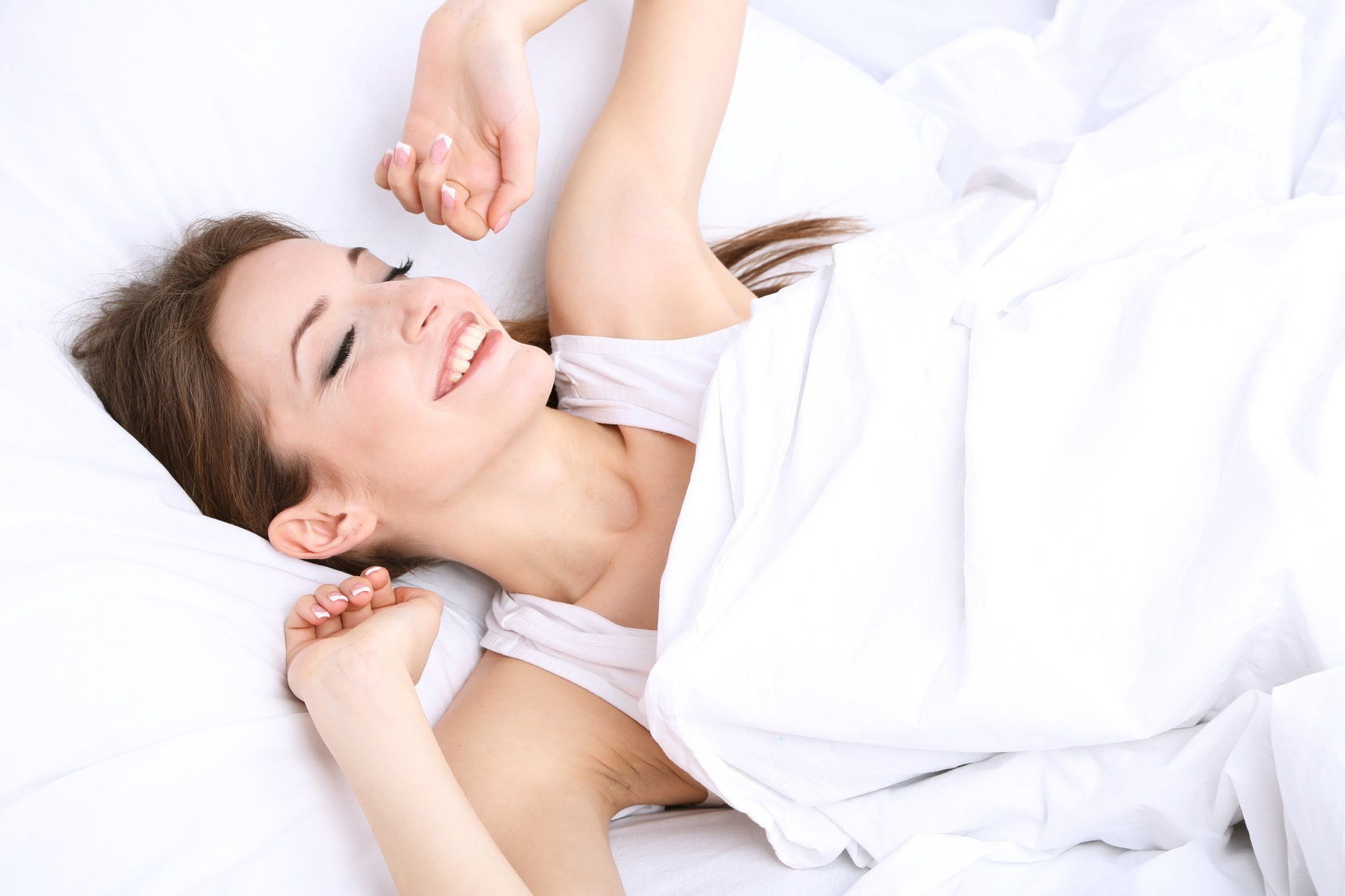 Young beautiful woman sleeping in bed close-up