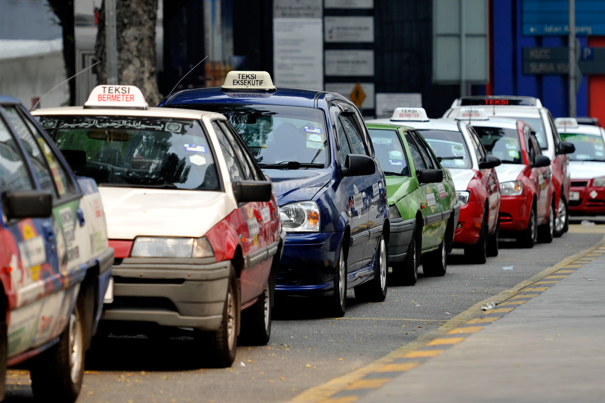 Taxis are parked as drivers wait for customers on a road in Kuala Lumpur on February 19, 2014. The Malaysian Insider/Najjua Zulkefli