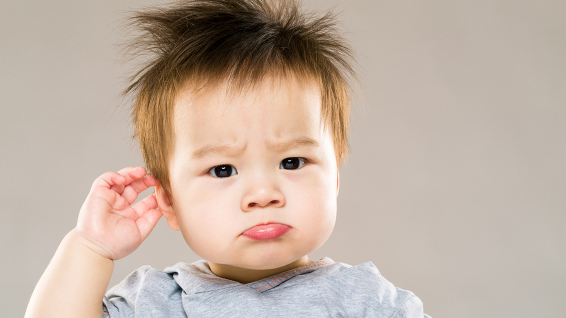 Confused baby boy hand touch ear; Shutterstock ID 195954584; PO: today.com