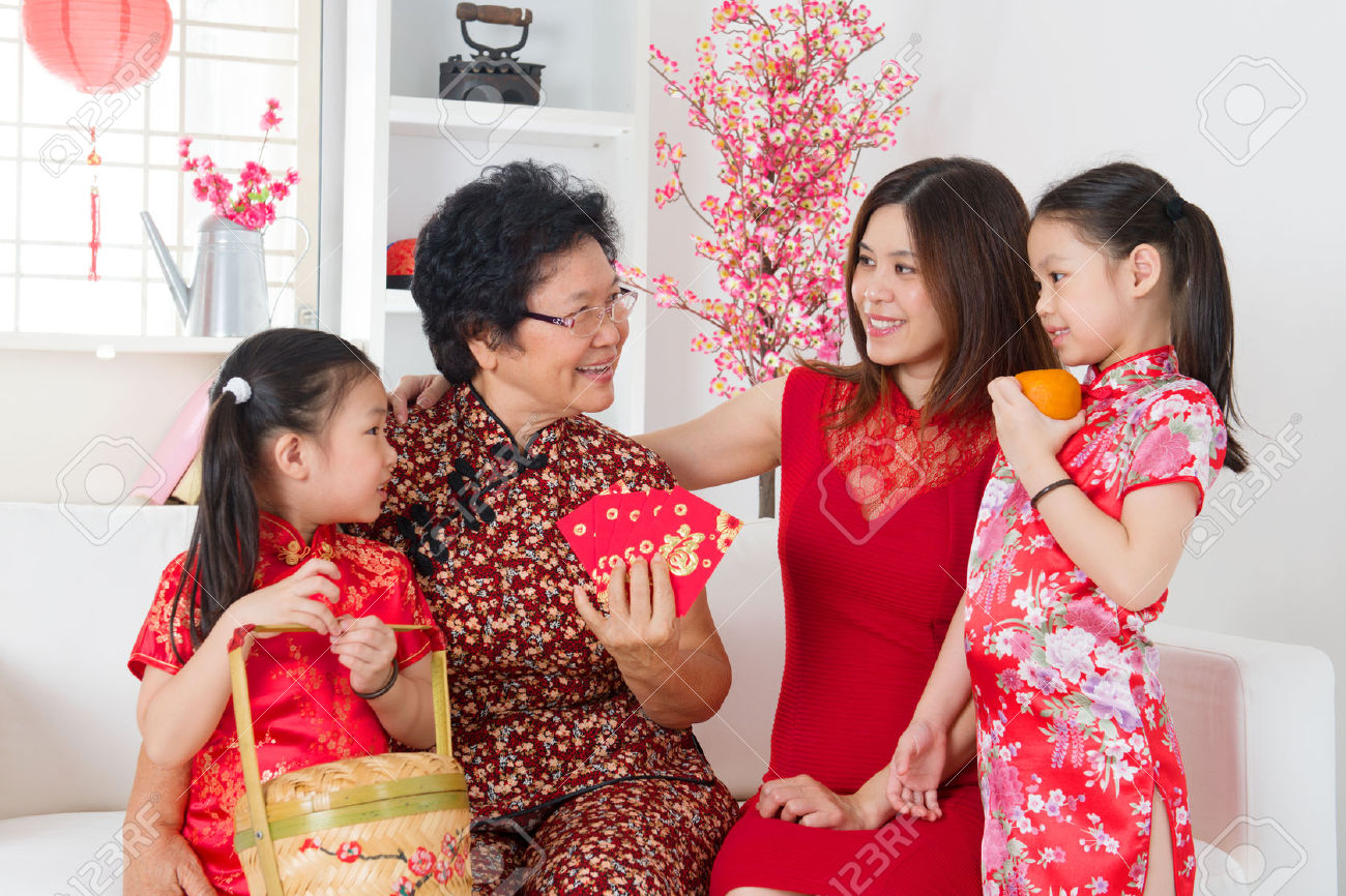 22284228-Happy-multi-generations-Asian-family-celebrate-Chinese-new-year-at-home--Stock-Photo