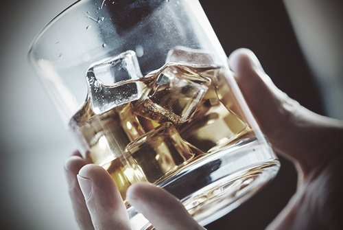 drugabuse-shutterstock231807016-hand_holding_glass_of_alcohol-feature_image-facts_on_alcohol