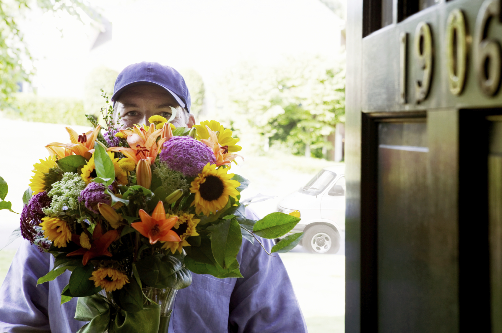 A courier delivering flowers.